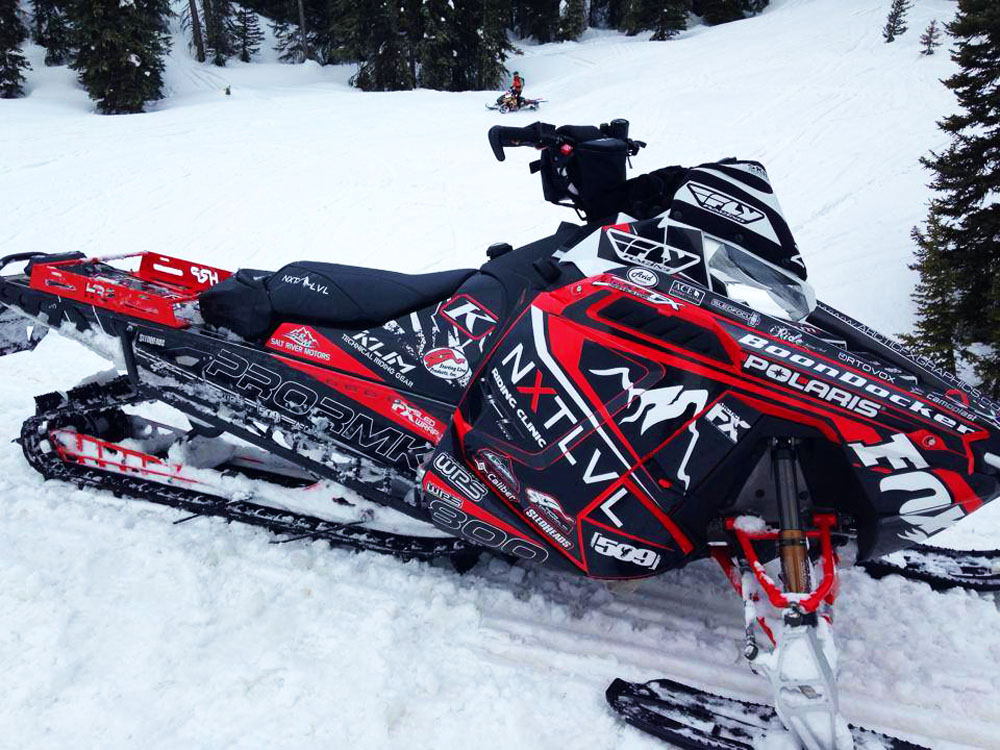 Dan Adams NXT LVL Signature sled wrap for a Polaris Pro RMK snowmobile designed by ArcticFX Graphics LLC - www.arcticfxgraphics.com