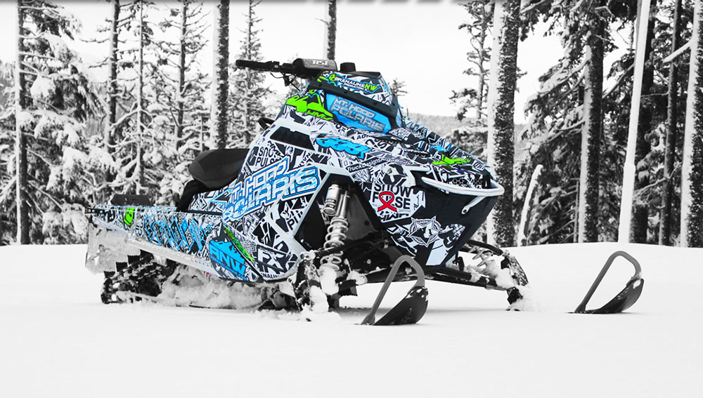 Custom sled wrap for a Polaris ProRMK snowmobile designed by ArcticFX Graphics LLC - www.arcticfxgraphics.com